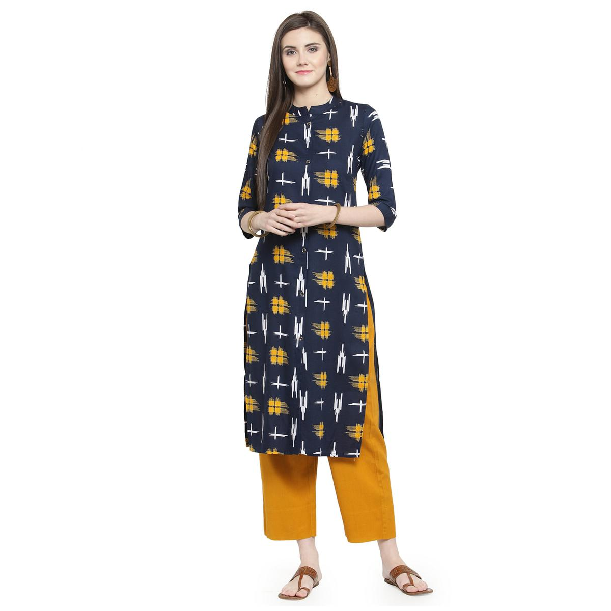 Engrossing Navy Blue Colored Casual Wear Printed Rayon Kurti