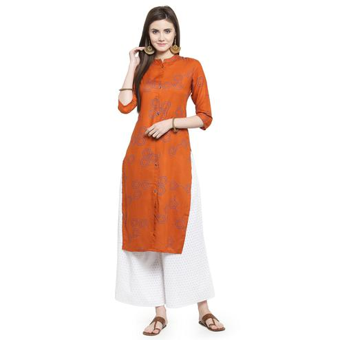 Refreshing Rust Orange Colored Casual Wear Printed Rayon Kurti