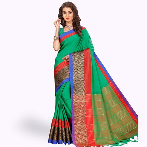 Engrossing Green Colored Festive Wear Woven Tissue Silk Saree