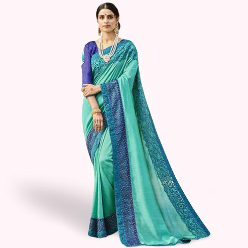 Exceptional Turquoise Blue Colored Party Wear Embroidered Georgette Saree
