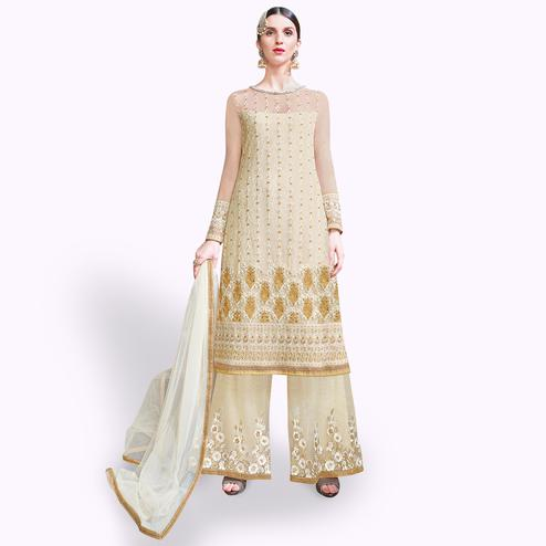 Stunning Cream Colored Partywear Embroidered Netted Palazzo Suit