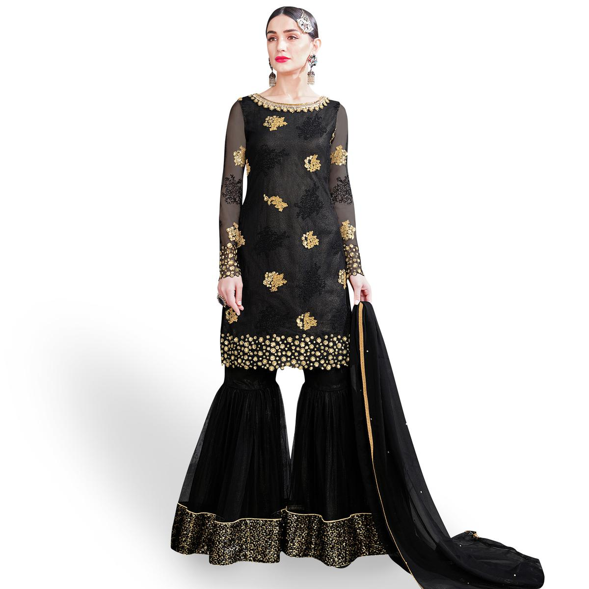 Flamboyant Black Colored Partywear Embroidered Netted Palazzo Suit