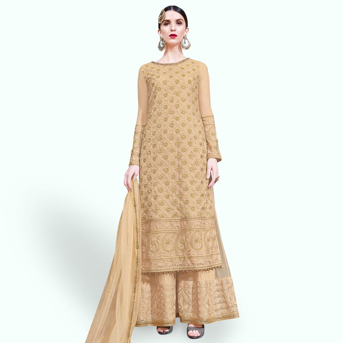 Classy Beige Colored Partywear Embroidered Netted Palazzo Suit