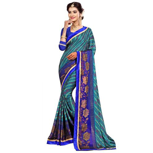 Magnetic Aqua Blue Colored Casual Wear Printed Georgette Saree