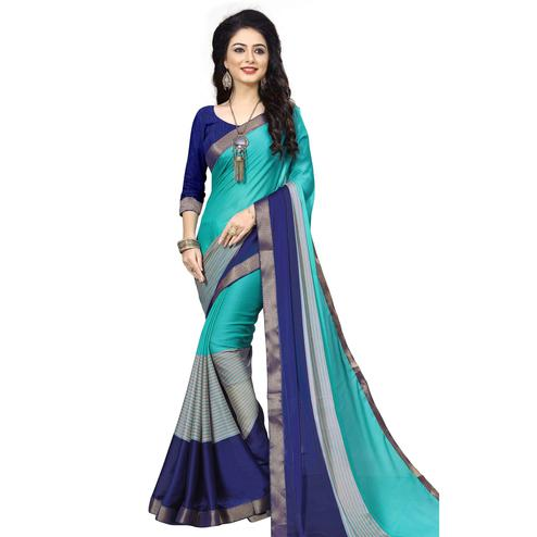 Flamboyant Turquoise Blue-Navy Blue Colored Casual Printed Georgette Saree