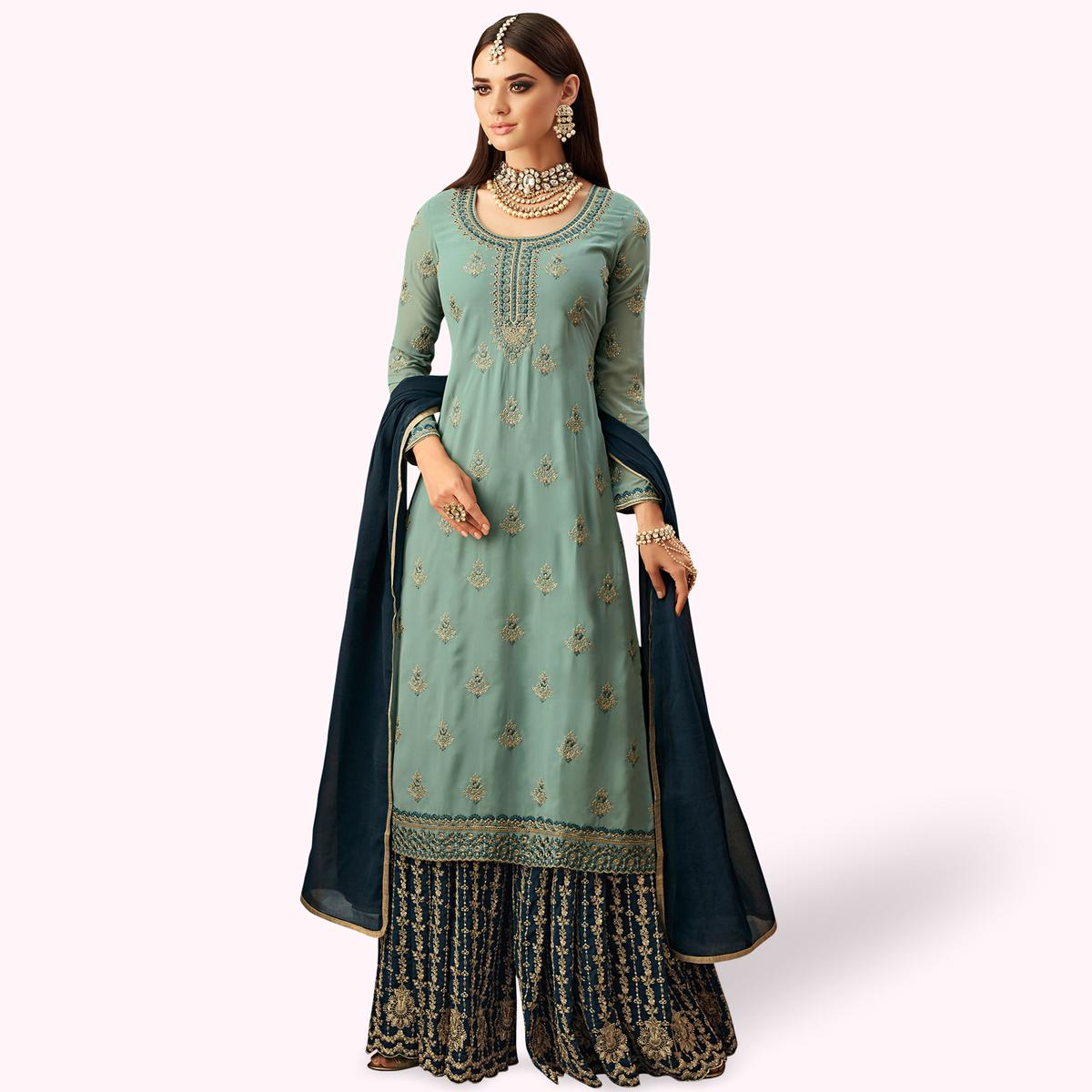 Stunning Cyan Blue Colored Partywear Embroidered Faux Georgette Palazzo Suit