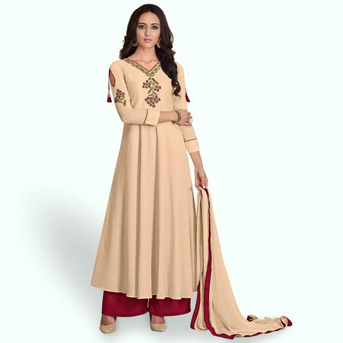 Attractive Beige Colored Partywear Embroidered Cotton Palazzo Suit