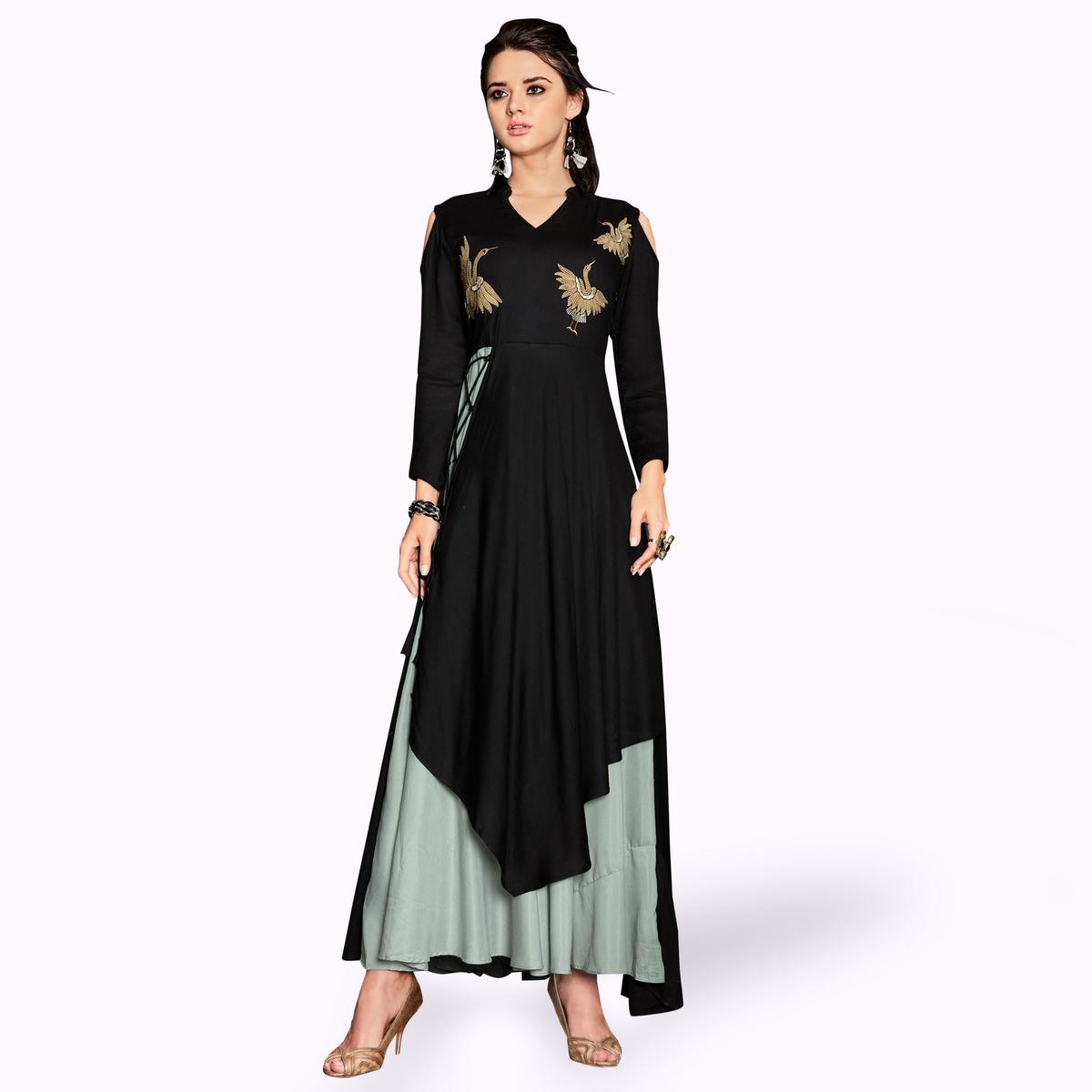 Magnetic Black Colored Party Wear Embroidered Rayon Kurti