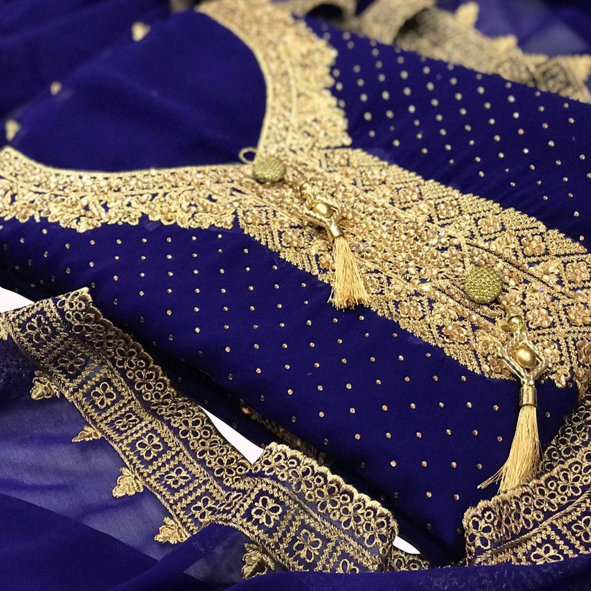 Amazing Blue Colored Partywear Embroidered Georgette Suit