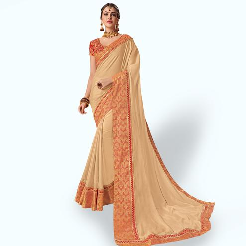 Unique Beige Colored Party Wear Embroidered Raw Silk Saree