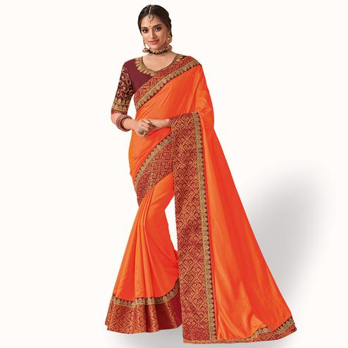 Refreshing Orange Colored Party Wear Embroidered Raw Silk Saree