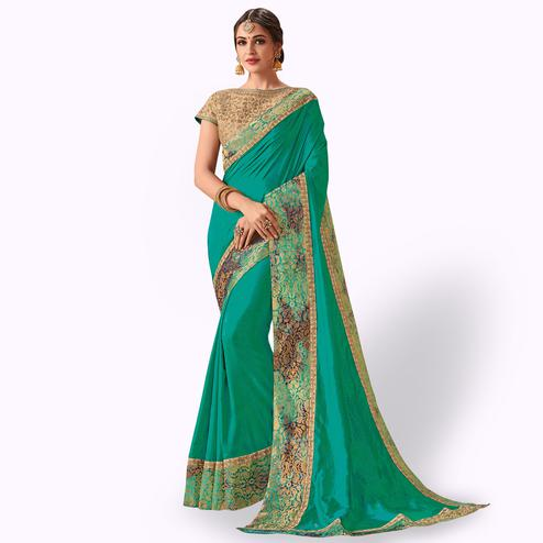 Excellent Turquoise Green Colored Party Wear Embroidered Raw Silk Saree