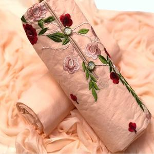 Beautiful Peach Colored Partywear Embroidered Cotton & Russel Net Dress Material