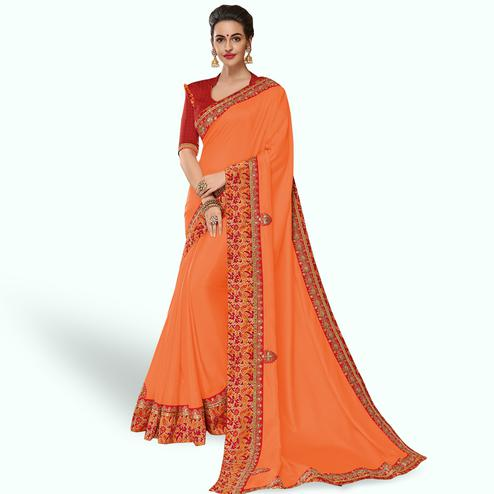 Pretty Peach Colored Partywear Embroidered Silk Saree