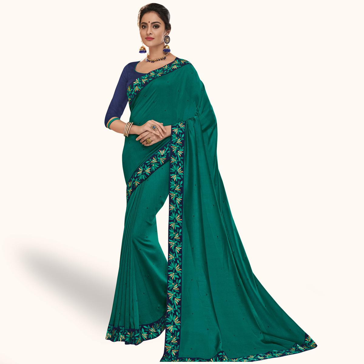 Charming Teal Green Colored Partywear Embroidered Silk Saree