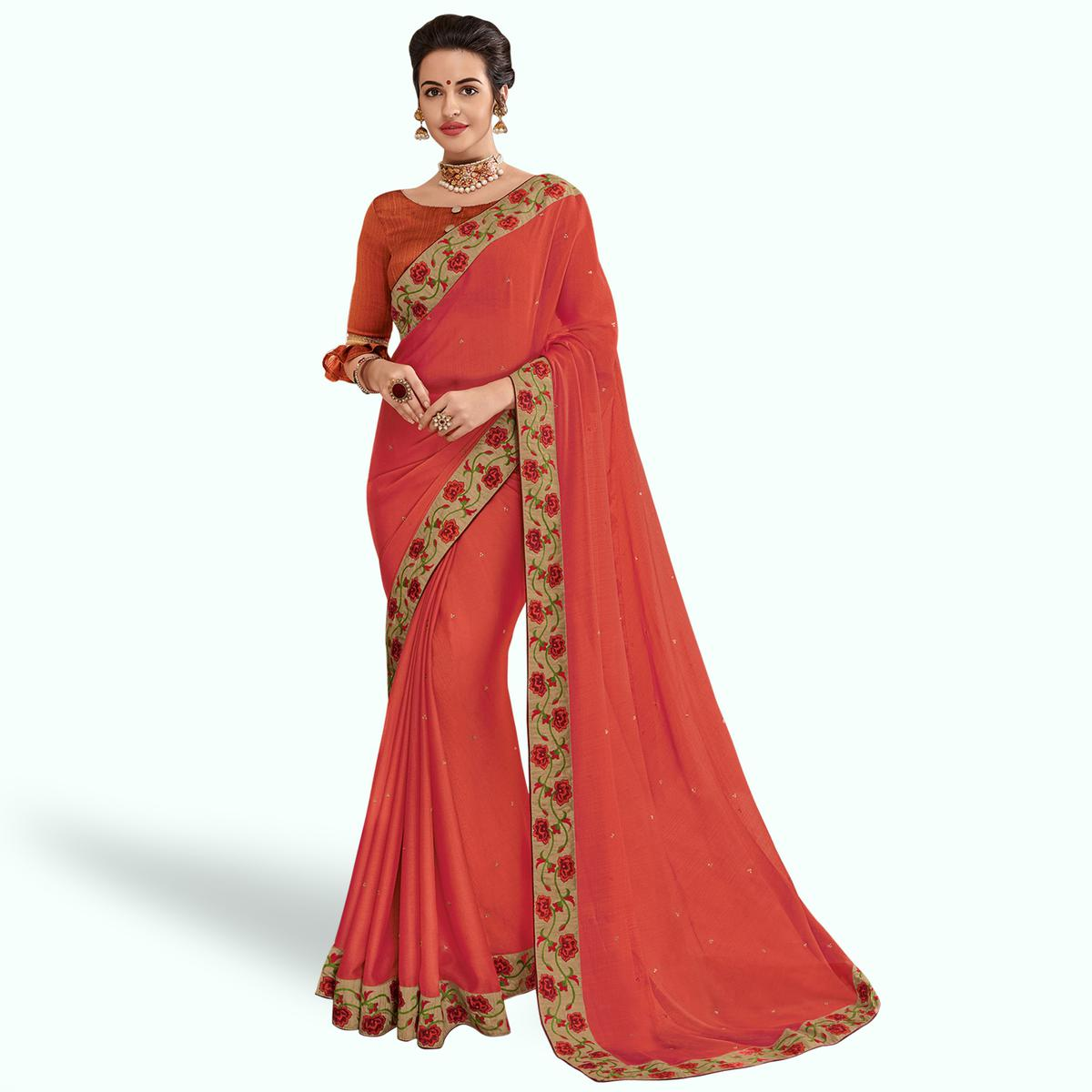 Engrossing Coral Red Colored Partywear Embroidered Georgette Saree