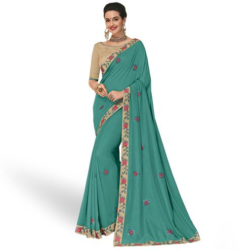 Entrancing Aqua Blue Colored Partywear Embroidered Georgette Saree