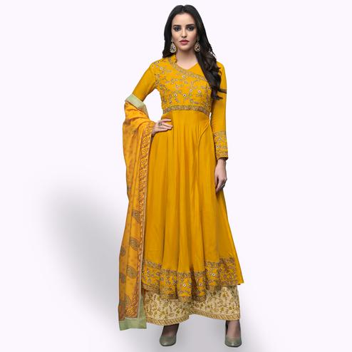 Elegant Yellow Colored Party Wear Embroidered Muslin Cotton Palazzo Suit
