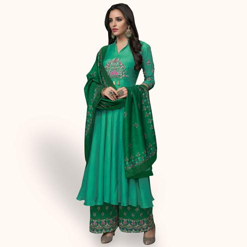 Impressive Turquoise Green Colored Party Wear Embroidered Muslin Cotton Palazzo Suit