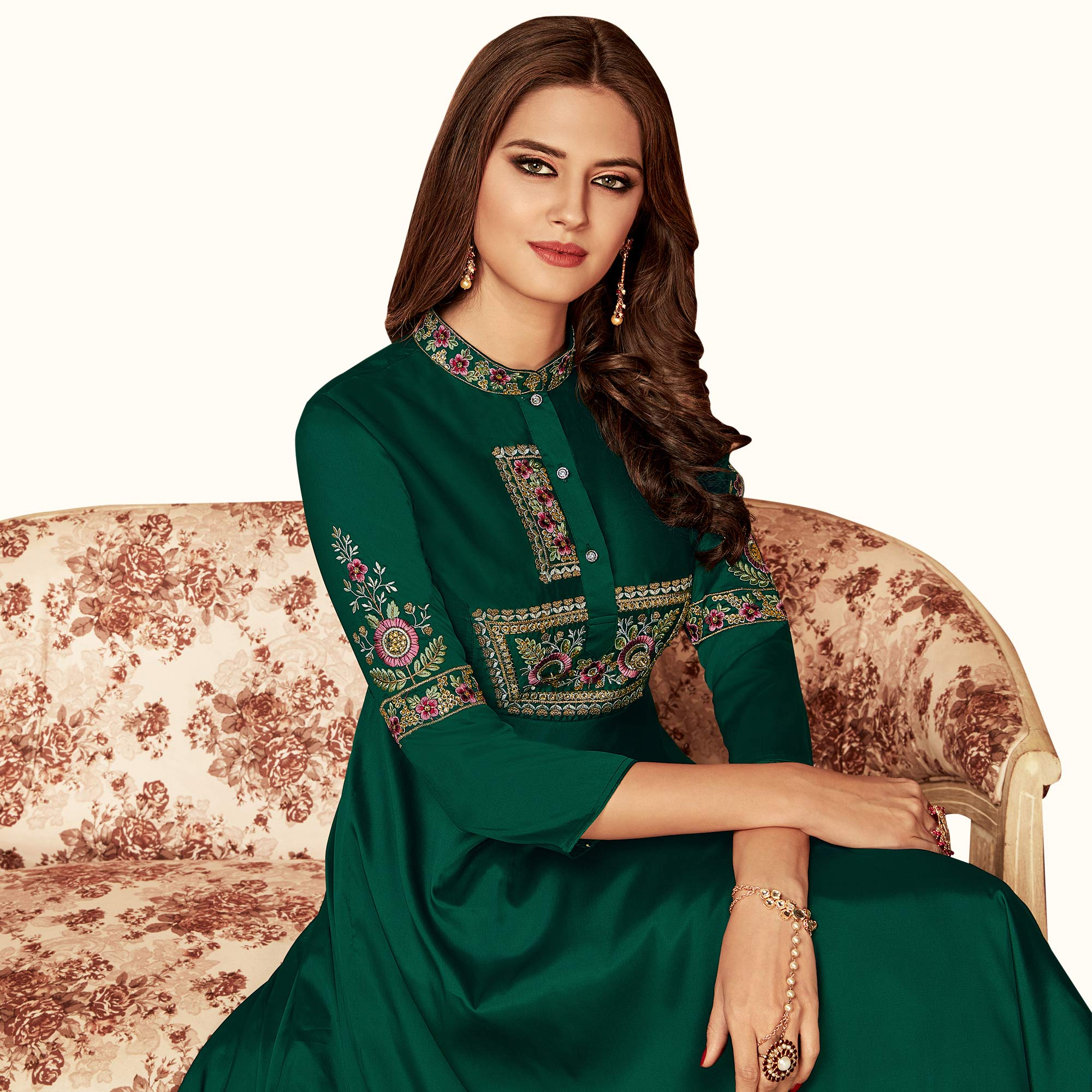 Mesmeric Green Colored Party Wear Embroidered Tapeta Silk Gown