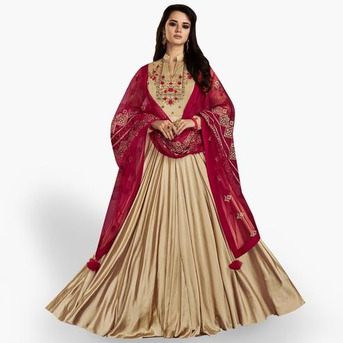 Capricious Beige Colored Partywear Embroidered Georgette Satin Anarkali Suit