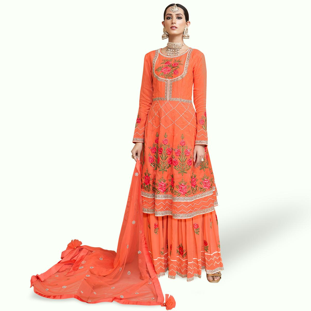 Stunning Orange Colored Partywear Embroidered Uppada Silk Palazzo Suit