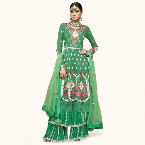 Marvellous Green Colored Partywear Embroidered Uppada Silk Palazzo Suit
