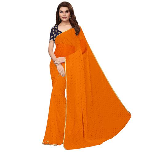 Delightful Orange Colored Partywear Chiffon Saree
