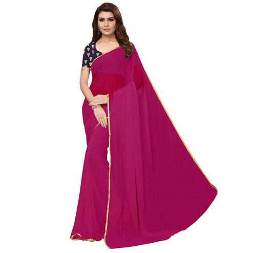 Engrossing Rani Pink Colored Partywear Printed Chiffon Saree