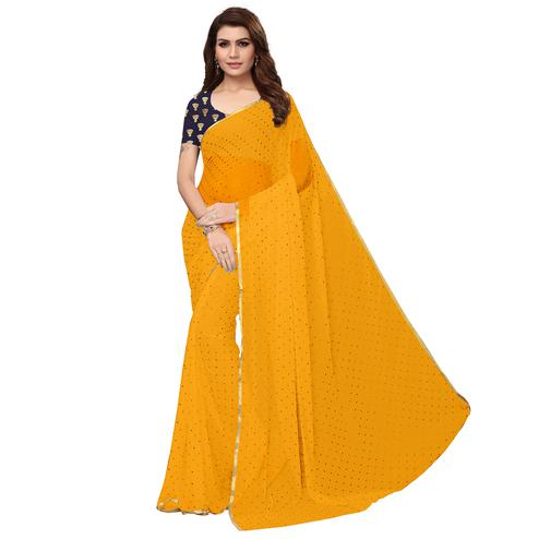 Eye-catching Yellow Colored Partywear Printed Chiffon Saree