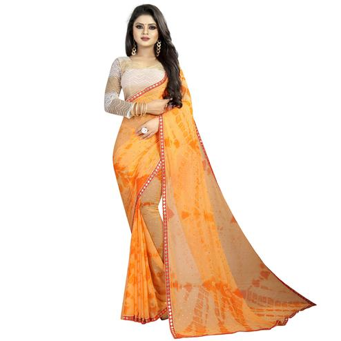 Flamboyant Light Orange Colored Partywear Printed Chiffon Saree