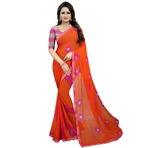 Pretty Orange Colored Casual Printed Chiffon Saree