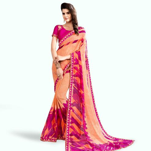 Elegant Peach-Pink Colored Partywear Printed Georgette Saree