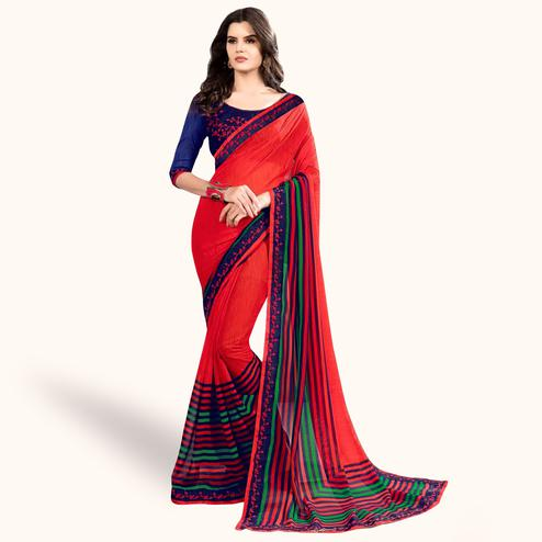 Glowing Coral Red Colored Partywear Printed Georgette Saree