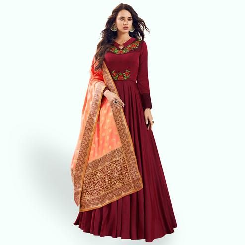 Charming Maroon Colored Partywear Embroidered Satin Anarkali Suit