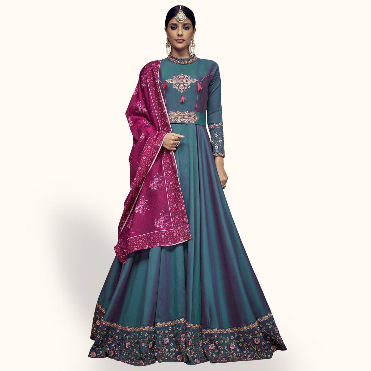 Stunning Blue Colored Partywear Embroidered Tapeta Silk Anarkali Suit