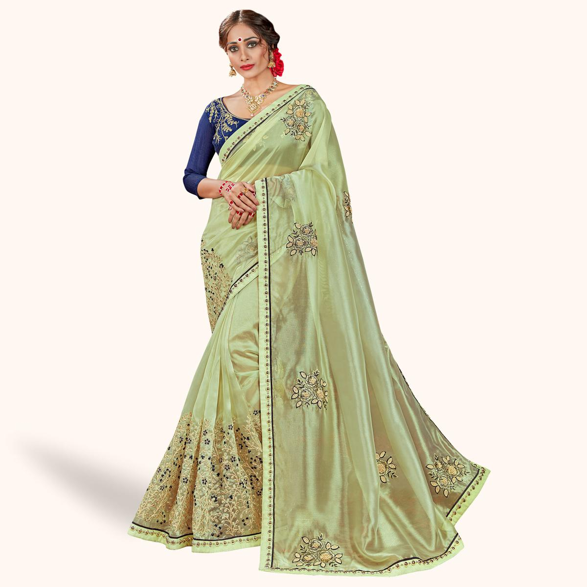 Staring Pista Green Colored Party Wear Embroidered Tissue Saree