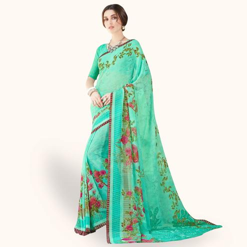 Flamboyant Turquoise Green Colored Casual Wear Printed Chiffon Saree