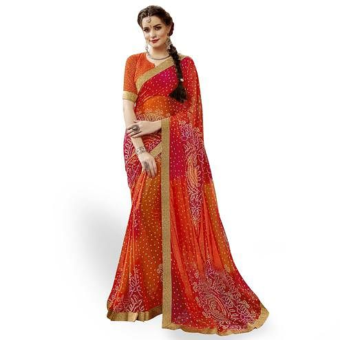 Glowing Orange Colored Partywear Printed Georgette Saree