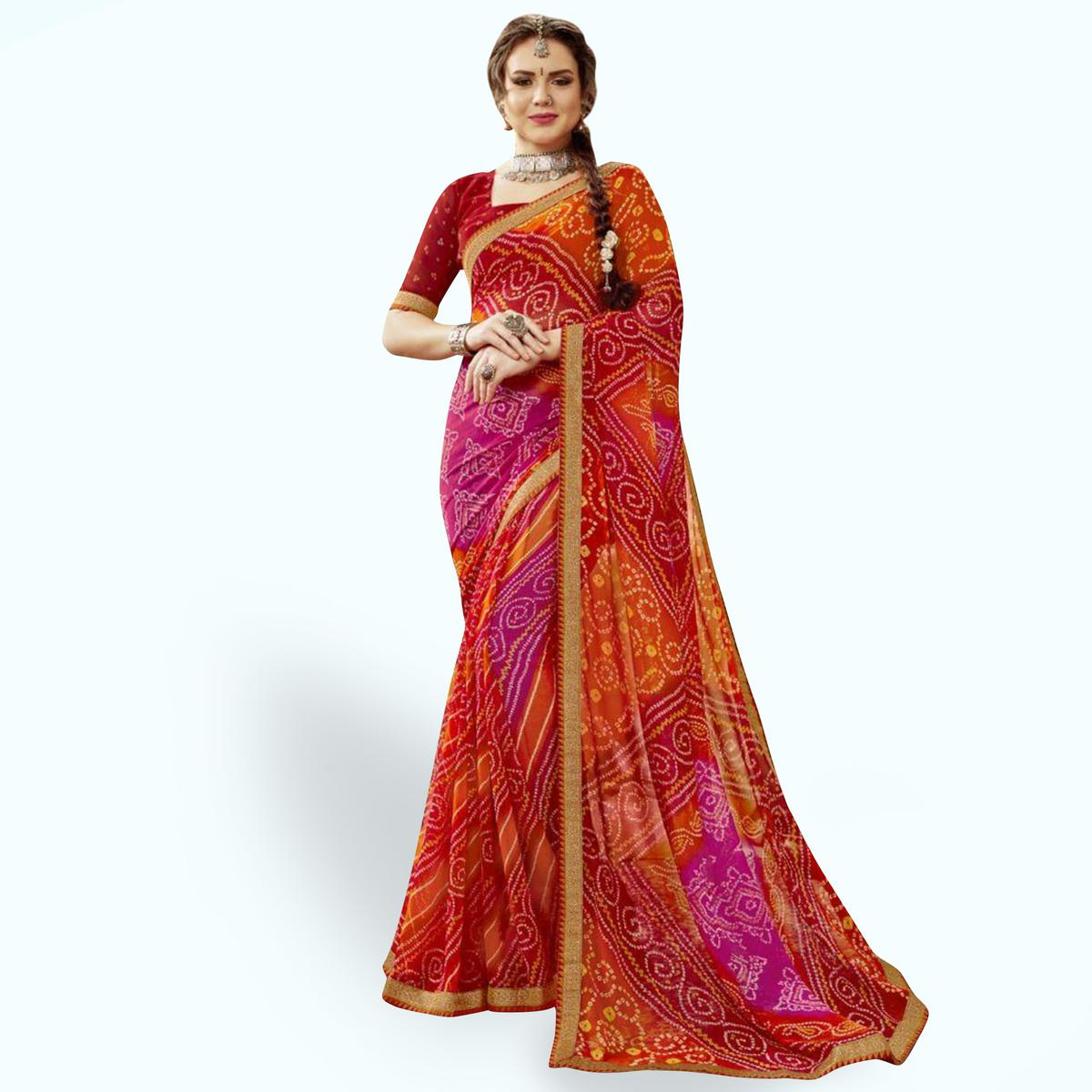 Exceptional Red-Orange Colored Partywear Printed Georgette Saree