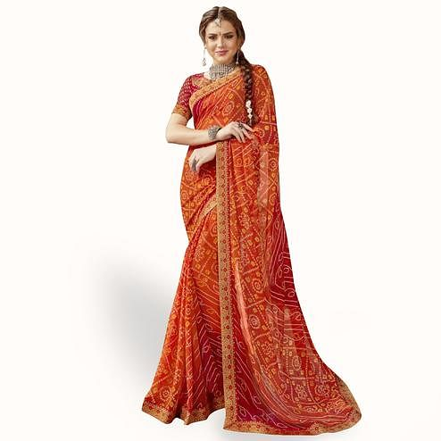 Hypnotic Orange Colored Partywear Printed Georgette Saree