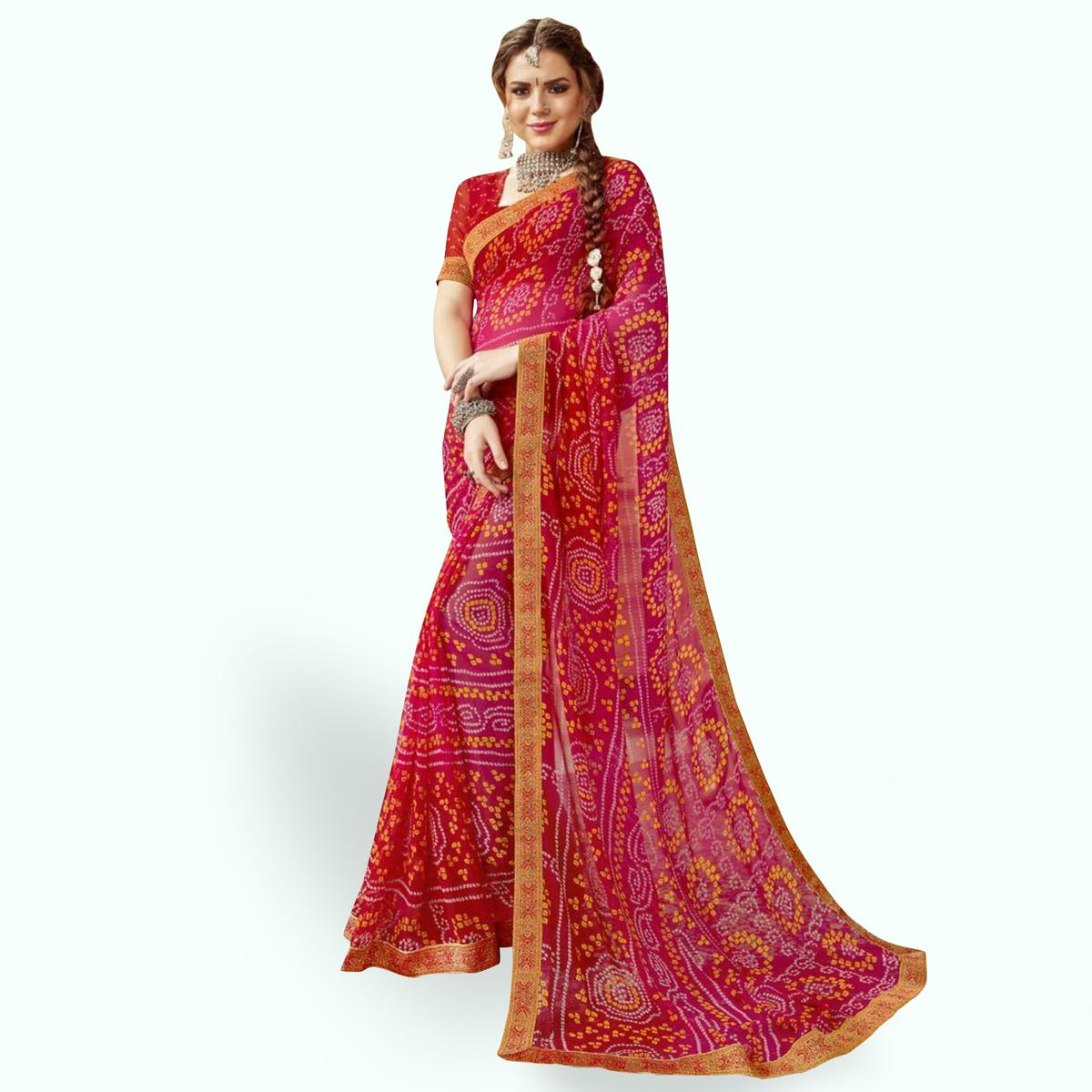 Flattering Pink-Red Colored Partywear Printed Georgette Saree