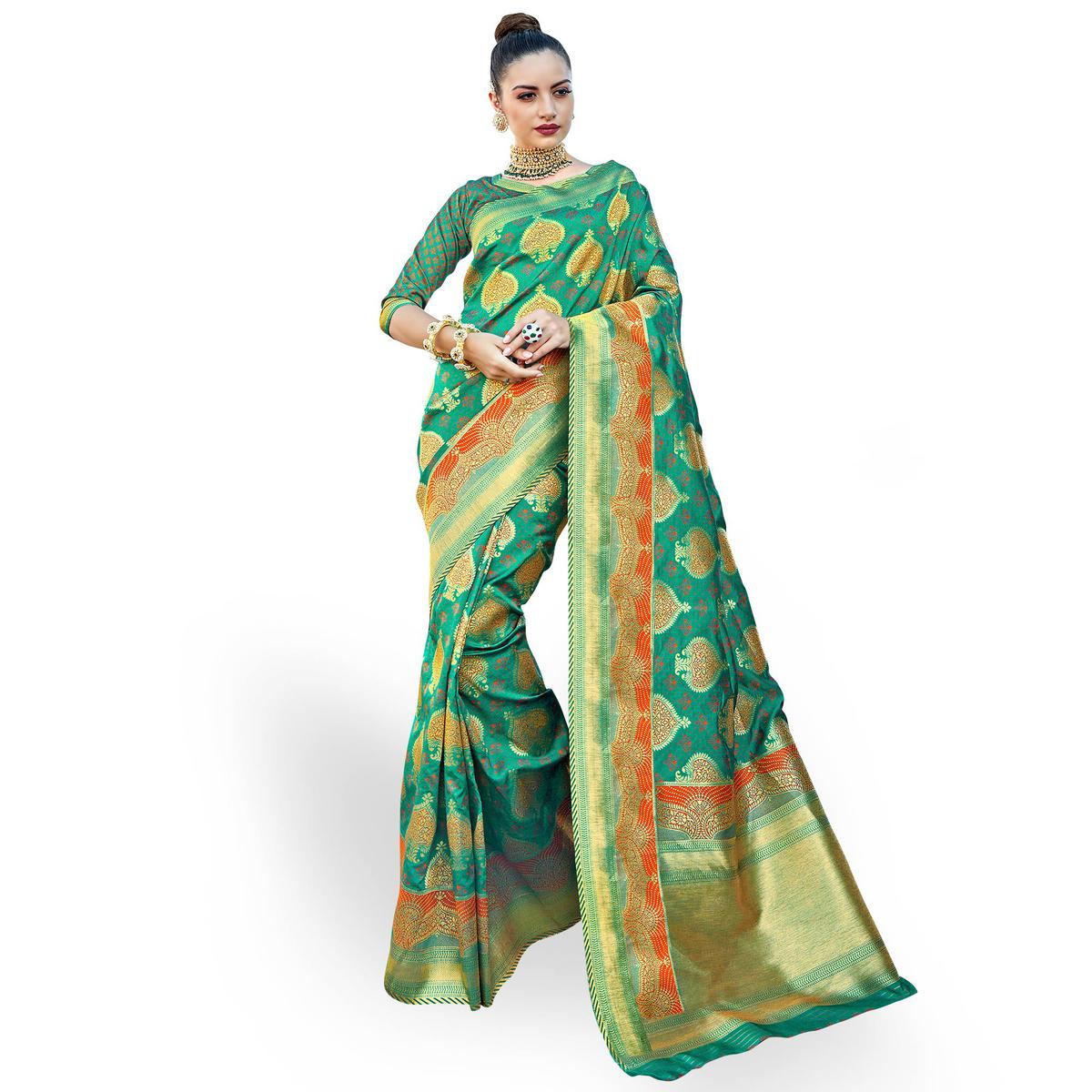Surpassing Green Colored Festive Wear Woven Crepe Saree
