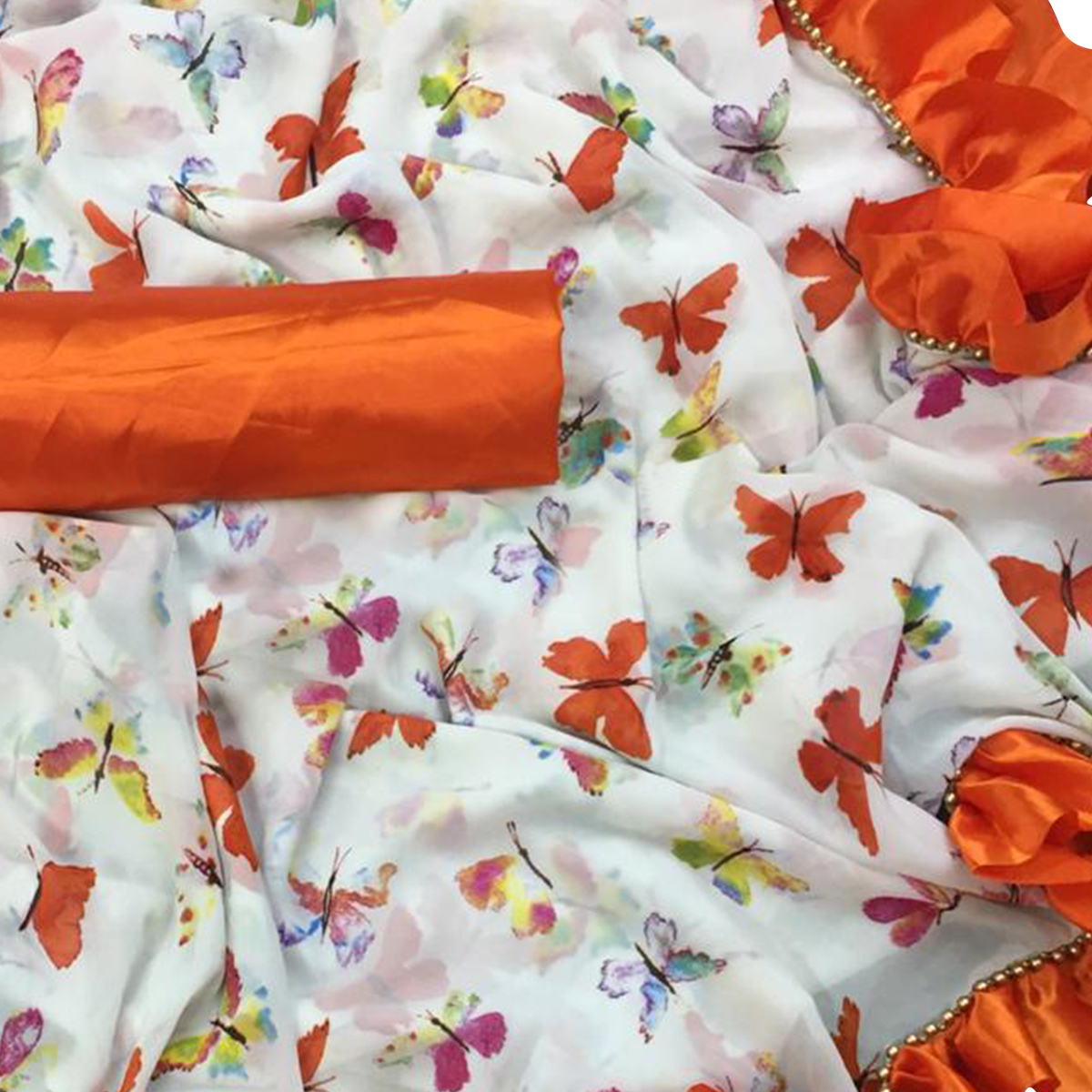 Engrossing White-Orange Colored Partywear Printed Georgette Saree