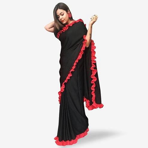 Eye-catching Black Colored Partywear Georgette Saree
