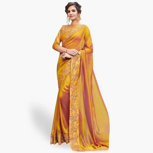 Imposing Mustard Yellow Colored Partywear Embroidered Raw Silk Saree