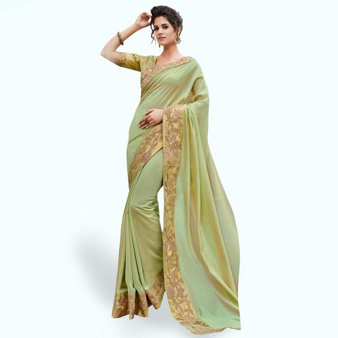 Mesmerising Pista Green Colored Partywear Embroidered Raw Silk Saree