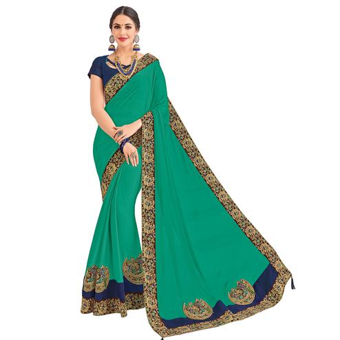 Glowing Green Colored Party Wear Embroidered Georgette Saree