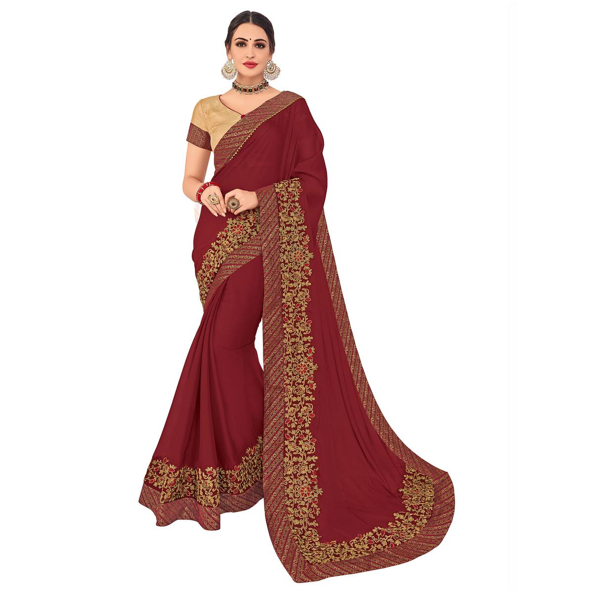 Demanding Maroon Colored Party Wear Embroidered Georgette Saree