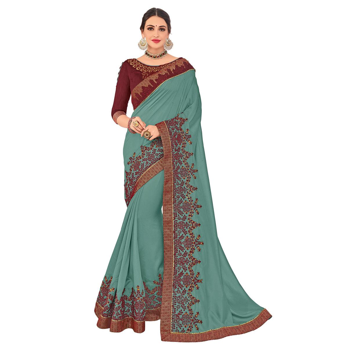 Flattering Cyan Colored Party Wear Embroidered Silk Saree